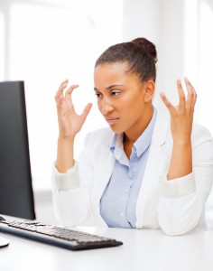 Stressed woman at desktop computer